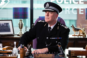 Scot Squad. Chief Commissioner Cameron Miekelson (Jack Docherty). Copyright: The Comedy Unit.