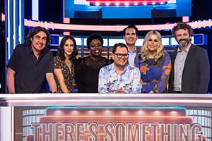 There's Something About Movies. Image shows from L to R: Micky Flanagan, Jessica Brown Findlay, Lolly Adefope, Alan Carr, Jimmy Carr, Roisin Conaty, Michael Sheen. Copyright: CPL Productions.