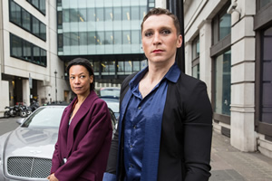 W1A. Image shows from L to R: Lucy Freeman (Nina Sosanya), Ryan Chelford (Ben Batt). Copyright: BBC.