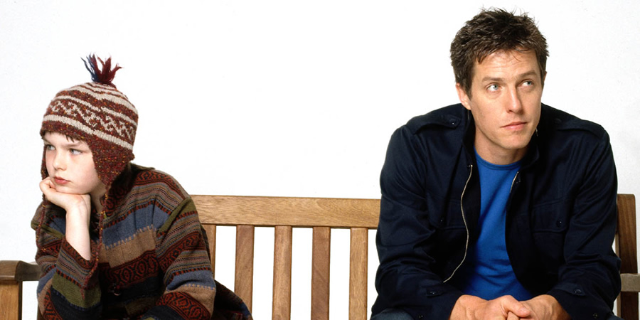 About A Boy. Image shows from L to R: Marcus (Nicholas Hoult), Will Freeman (Hugh Grant).