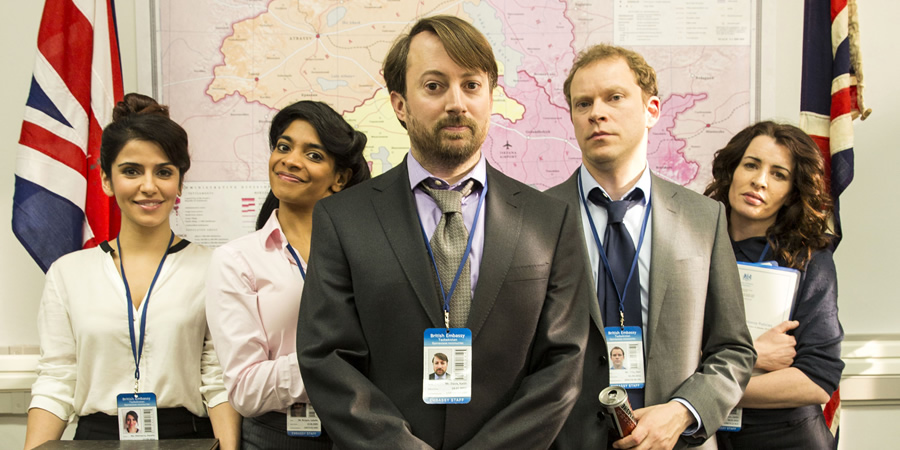 Ambassadors. Image shows from L to R: Natalia (Shivani Ghai), Isabel (Amara Karan), Keith Davis (David Mitchell), Neil Tilly (Robert Webb), Caitlin (Susan Lynch).