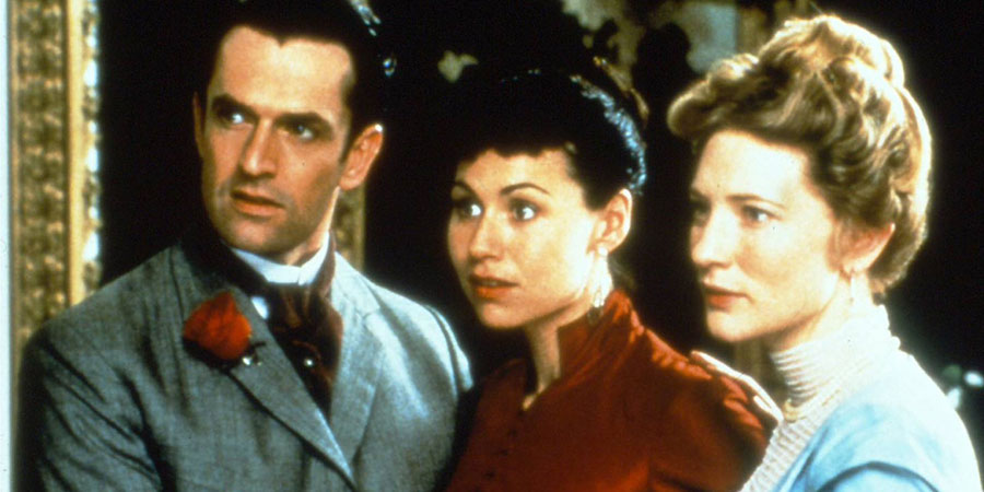 An Ideal Husband. Image shows from L to R: Lord Arthur Goring (Rupert Everett), Miss Mabel Charlton (Minnie Driver), Gertrude Charlton (Cate Blanchett). Copyright: Miramax Films.