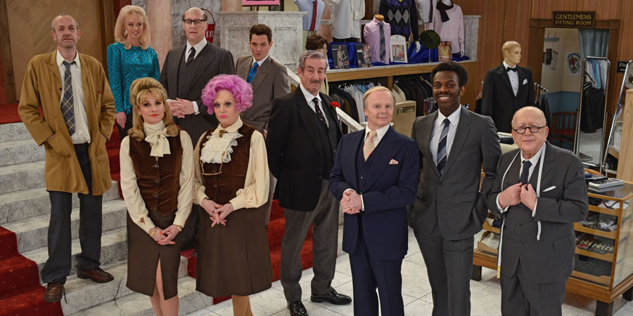 Are You Being Served?. Image shows from L to R: Mr Harman (Arthur Smith), Miss Croft (Jorgie Porter), Miss Brahms (Niky Wardley), Mr Rumbold (Justin Edwards), Mrs Slocombe (Sherrie Hewson), Young Mr Grace (Mathew Horne), Captain Peacock (John Challis), Mr Humphries (Jason Watkins), Mr Conway (Kayode Ewumi), Mr Grainger (Roy Barraclough). Copyright: BBC.