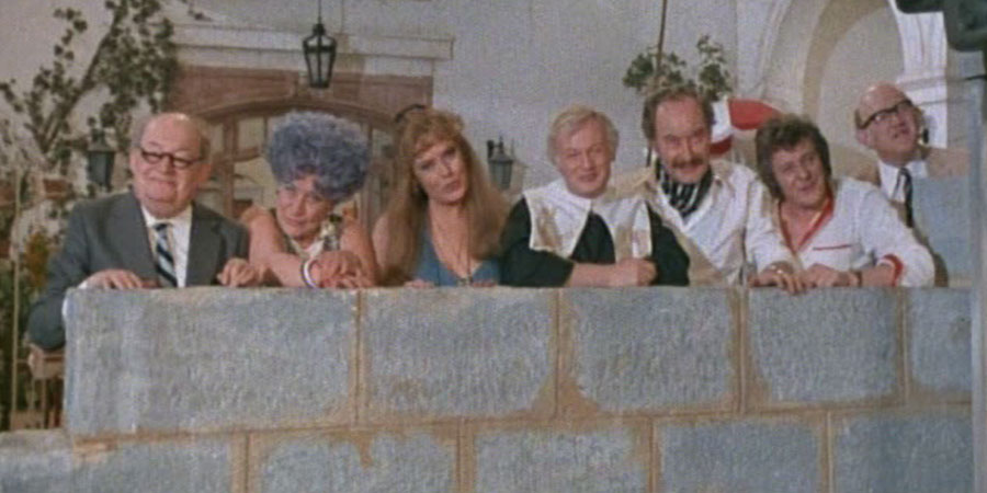 Are You Being Served?. Image shows from L to R: Mr. Ernest Grainger (Arthur Brough), Mrs. Betty Slocombe (Mollie Sugden), Miss Shirley Brahms (Wendy Richard), Mr. Wilberforce Clayborne Humphries (John Inman), Captain Stephen Peacock (Frank Thornton), Mr. Dick Lucas (Trevor Bannister), Mr. Cuthbert Rumbold (Nicholas Smith). Copyright: Anglo-EMI.