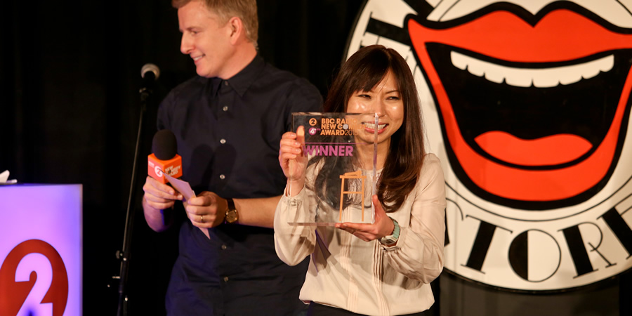BBC New Comedy Award. Image shows from L to R: Patrick Kielty, Yuriko Kotani. Copyright: BBC.