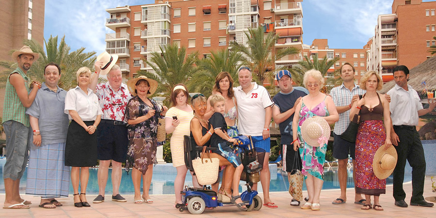 Benidorm. Image shows from L to R: Troy (Paul Bazely), Gavin (Hugh Sachs), Janey York (Crissy Rock), Donald Stewart (Kenny Ireland), Jacqueline Stewart (Janine Duvitski), Chantelle Garvey (Hannah Hobley), Madge (Sheila Reid), Michael Garvey (Oliver Stokes), Janice Garvey (Siobhan Finneran), Mick Garvey (Steve Pemberton), The Oracle (Johnny Vegas), Noreen Maltby (Elsie Kelly), Martin Weedon (Nicholas Burns), Kate Weedon (Abigail Cruttenden), Mateo (Jake Canuso). Copyright: Tiger Aspect Productions.