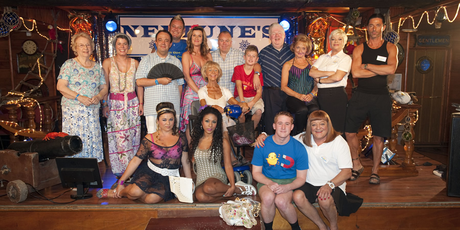 Benidorm. Image shows from L to R: Noreen Maltby (Elsie Kelly), Pauline (Selina Griffiths), Gavin (Hugh Sachs), Sam (Shelley Longworth), Kenneth (Tony Maudsley), Janice Garvey (Siobhan Finneran), Natalie (Kathryn Drysdale), Madge (Sheila Reid), Mick Garvey (Steve Pemberton), Michael Garvey (Oliver Stokes), Donald Stewart (Kenny Ireland), Liam (Adam Gillen), Jacqueline Stewart (Janine Duvitski), Les / Lesley (Tim Healy), Janey York (Crissy Rock), Mateo (Jake Canuso). Copyright: Tiger Aspect Productions.