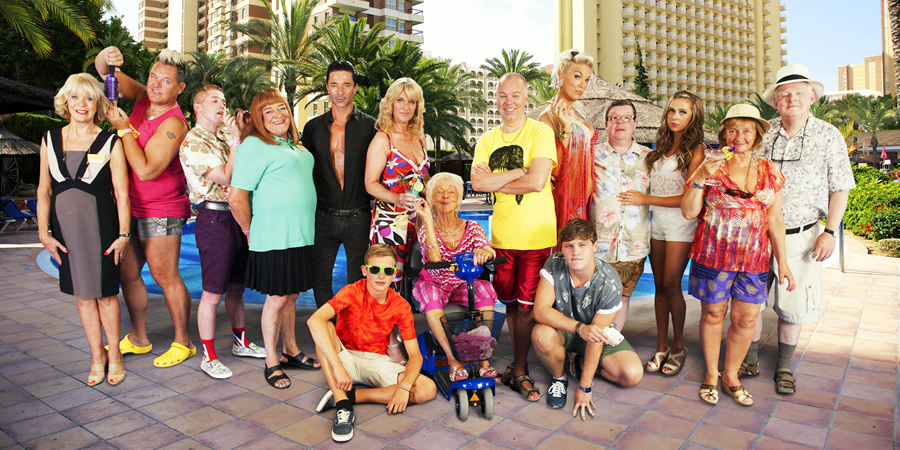 Benidorm. Image shows from L to R: Joyce Temple Savage (Sherrie Hewson), Kenneth (Tony Maudsley), Liam (Adam Gillen), Les / Lesley (Tim Healy), Mateo (Jake Canuso), Janice Garvey (Siobhan Finneran), Michael Garvey (Oliver Stokes), Madge (Sheila Reid), Mick Garvey (Steve Pemberton), Tonya Dyke (Hannah Waddingham), Tiger Dyke (Danny Walters), Clive Dyke (Perry Benson), Bianca Dyke (Bel Powley), Jacqueline Stewart (Janine Duvitski), Donald Stewart (Kenny Ireland). Copyright: Tiger Aspect Productions.
