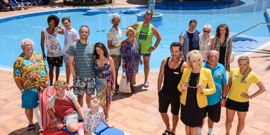 Benidorm. Image shows from L to R: Eddie Dawson (Bobby Knutt), Joey Ellis (Nathan Bryon), Tiger Dyke (Danny Walters), Rob Dawson (Josh Bolt), Jodie Dawson (Honor Kneafsey), Billy Dawson (Steve Edge), Sheron Dawson (Julie Graham), Troy (Paul Bazely), Jacqueline Stewart (Janine Duvitski), Kenneth (Tony Maudsley), Mateo (Jake Canuso), The Oracle (Johnny Vegas), Joyce Temple Savage (Sherrie Hewson), Noreen Maltby (Elsie Kelly), Les / Lesley (Tim Healy), Pauline (Selina Griffiths), Amber (Jessica Ellerby). Copyright: Tiger Aspect Productions.