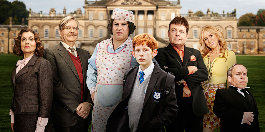 Billionaire Boy. Image shows from L to R: Miss Sharpe (Rebecca Front), Mr Darrow (James Fleet), Mrs. Trafe (David Walliams), Joe Spud (Elliot Sprakes), Len Spud (John Thomson), Sapphire Diamond (Catherine Tate), Warwick Davis. Copyright: King Bert Productions.
