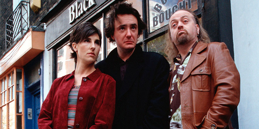 Black Books. Image shows from L to R: Fran Katzenjammer (Tamsin Greig), Bernard Black (Dylan Moran), Manny Bianco (Bill Bailey). Copyright: Assembly Film And Television.
