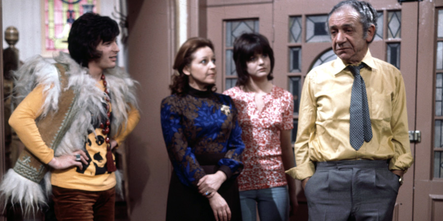 Bless This House. Image shows from L to R: Mike Abbott (Robin Stewart), Jean Abbott (Diana Coupland), Sally Abbott (Sally Geeson), Sid Abbott (Sid James). Copyright: Thames Television.