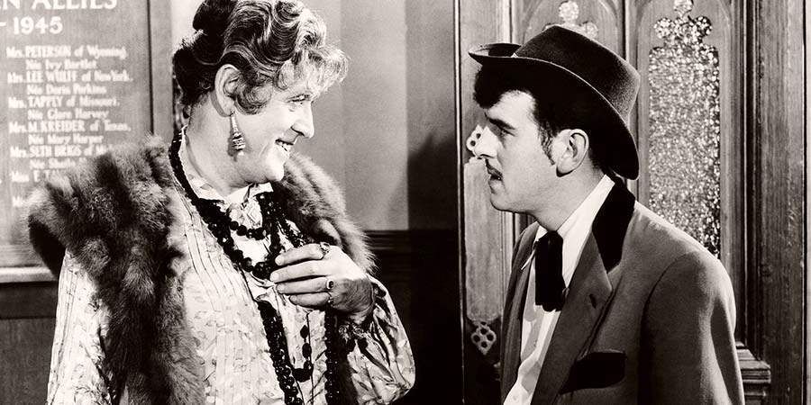 Blue Murder At St. Trinian's. Image shows from L to R: Miss Fritton (Alastair Sim), Flash Harry (George Cole). Copyright: John Harvel Productions / Studio Canal.