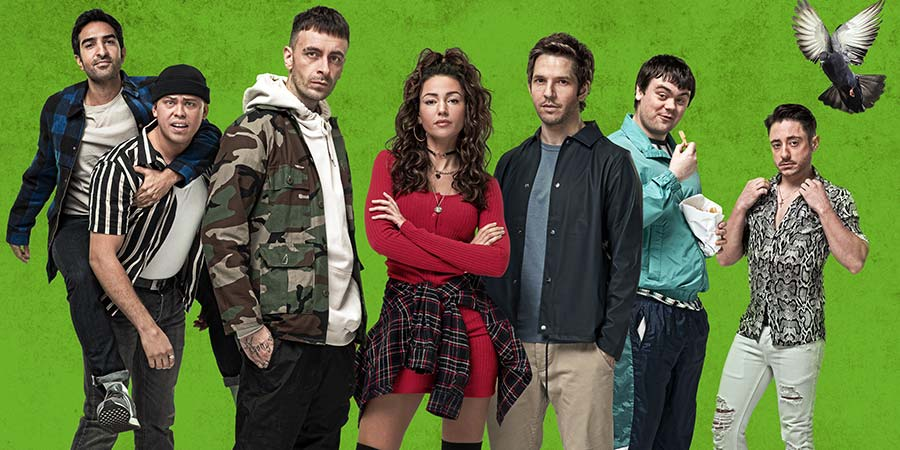 Brassic. Image shows from L to R: JJ (Parth Thakerar), Ash (Aaron Heffernan), Vinnie (Joe Gilgun), Erin (Michelle Keegan), Dylan (Damien Molony), Cardi (Tom Hanson), Tommo (Ryan Sampson). Copyright: Calamity Films.