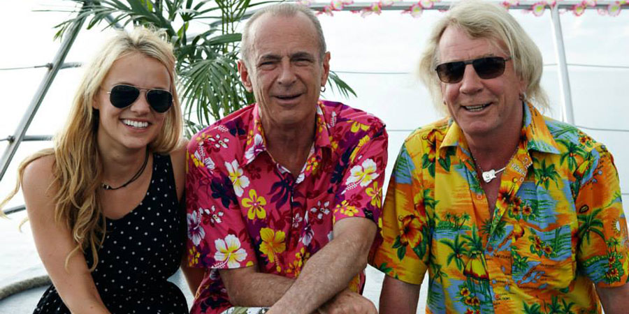 Bula Quo!. Image shows from L to R: Caroline (Laura Aikman), Francis (Francis Rossi), Rick (Rick Parfitt). Copyright: Status Quo Films.