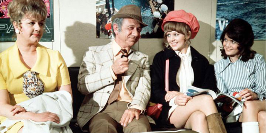 Carry On Abroad. Image shows from L to R: Cora Flange (Joan Sims), Vic Flange (Sidney James), Marge (Carol Hawkins), Lily Mays (Sally Geeson). Copyright: Peter Rogers Productions.