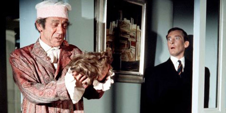 Carry On Again Doctor. Image shows from L to R: Gladstone Screwer (Sidney James), Dr Frederick Carver (Kenneth Williams).
