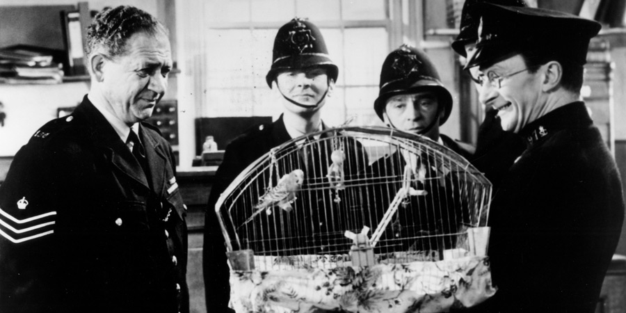 Carry On, Constable. Image shows from L to R: Sgt. Frank Wilkins (Sid James), Constable Benson (Kenneth Williams), Constable Charlie Constable (Kenneth Connor), Special Constable Timothy Gorse (Charles Hawtrey). Copyright: Peter Rogers Productions.