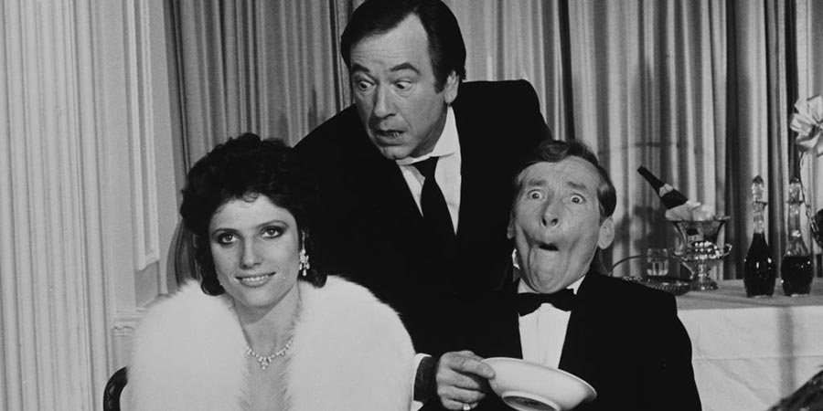 Carry On Emmannuelle. Image shows from L to R: Emmannuelle Prevert (Suzanne Danielle), Lyons (Jack Douglas), Ambassador Emile Prevert (Kenneth Williams).