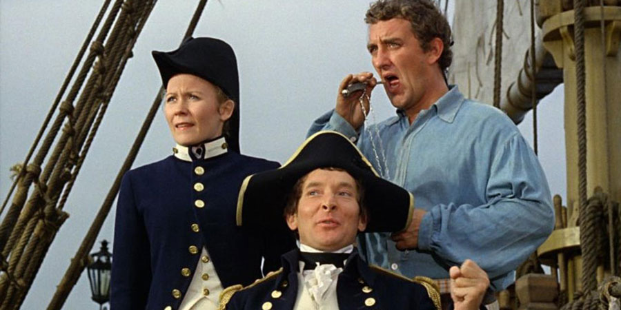 Carry On Jack. Image shows from L to R: Sally (Juliet Mills), Captain Fearless (Kenneth Williams), Midshipman Albert Poop-Decker (Bernard Cribbins).