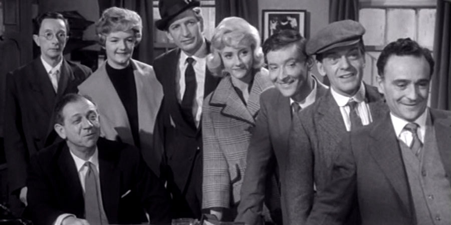Carry On Regardless. Image shows from L to R: Gabriel Dimple (Charles Hawtrey), Bert Handy (Sid James), Sister (Hattie Jacques), Montgomery Infield-Hopping (Terence Longdon), Delia King (Liz Fraser), Francis Courtenay (Kenneth Williams), Mike Weston (Bill Owen), Sam Twist (Kenneth Connor). Copyright: Peter Rogers Productions.