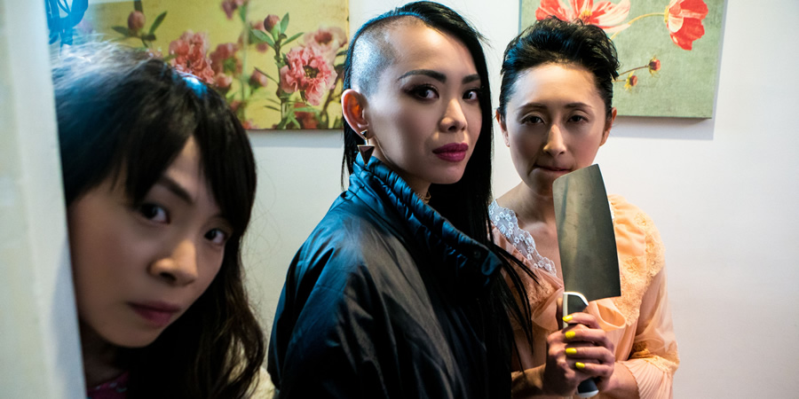 Chinese Burn. Image shows from L to R: Elizabeth (Shin-Fei Chen), Jackie (Yennis Cheung), FuFu (Yuyu Rau). Copyright: Roughcut Television.