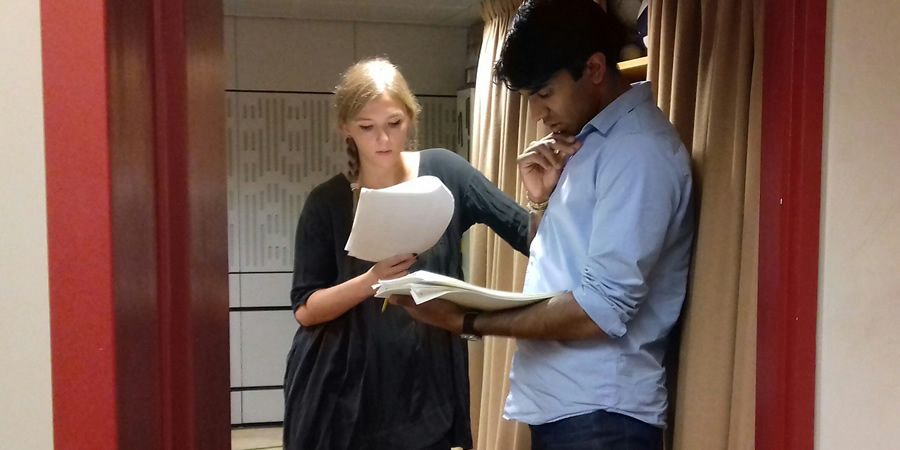 Cooking In A Bedsitter. Image shows from L to R: Trisha (Beattie Edmondson), Deepak (Nikesh Patel). Copyright: BBC.
