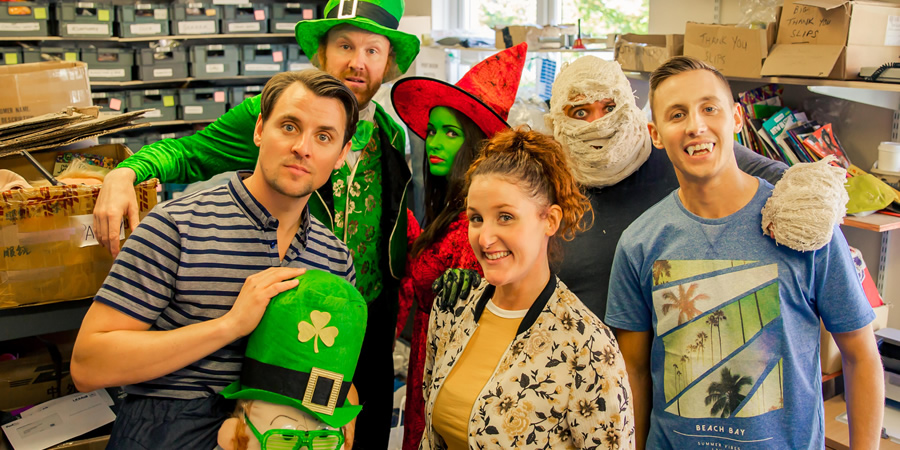 Costume Drama. Image shows from L to R: Shop Owner (Peter Campion), Leprechaun (Jason Byrne), Julie (Karen Hassan), Shop Owner (Bronagh Waugh), Ammon (David Elliott), Michael (Shane Todd).