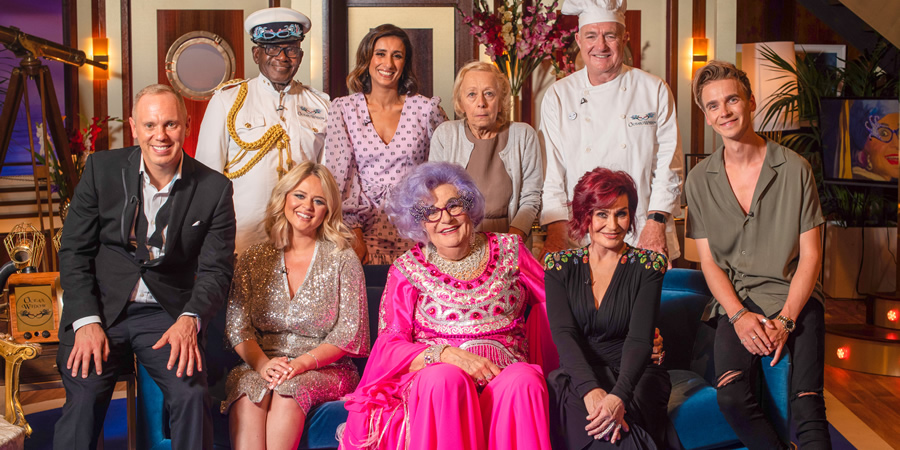 Dame Edna Rules The Waves. Image shows from L to R: Robert Rinder, Rudolph Walker, Emily Atack, Anita Rani, Dame Edna Everage (Barry Humphries), Mabel (Anne Rason), Rick Stein, Sharon Osbourne, Joe Sugg.