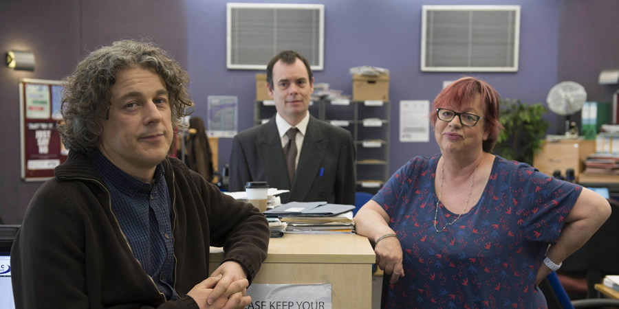Damned. Image shows from L to R: Al Kavanagh (Alan Davies), Martin Bickerstaff (Kevin Eldon), Rose Denby (Jo Brand).