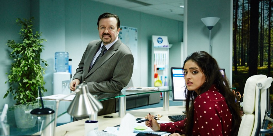 David Brent: Life On The Road. Image shows from L to R: David Brent (Ricky Gervais), Karen Parashar (Mandeep Dhillon).
