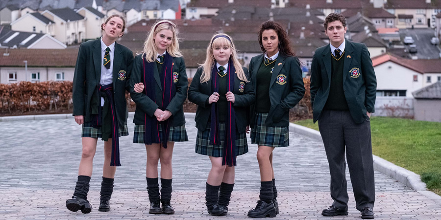 Derry Girls. Image shows from L to R: Orla McCool (Louisa Harland), Erin Quinn (Saoirse-Monica Jackson), Clare Devlin (Nicola Coughlan), Michelle Mallon (Jamie-Lee O'Donnell), James Maguire (Dylan Llewellyn). Copyright: Hat Trick Productions.