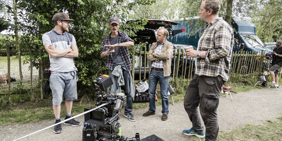 Behind-the-scenes on Detectorists. Image shows from L to R: Unknown, Andy Stone (Mackenzie Crook), Lance Stater (Toby Jones), Unknown.
