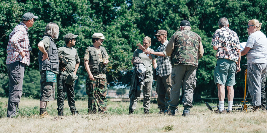 Behind-the-scenes on Detectorists. Image shows from L to R: Unknown, Russell (Pearce Quigley), Hugh (Divian Ladwa), Paul (Paul Casar), Louise (Laura Checkley), Andy Stone (Mackenzie Crook), Unknown, Unknown, Unknown.