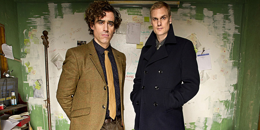 Dirk Gently. Image shows from L to R: Dirk Gently (Stephen Mangan), Richard MacDuff (Darren Boyd). Copyright: The Welded Tandem Picture Company.
