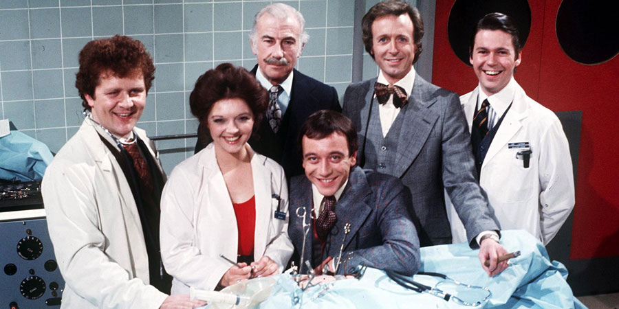 Doctor On The Go. Image shows from L to R: Andrew MacKenzie (John Kane), Katherine Wright (Jacquie-Ann Carr), Sir Geoffrey Loftus (Ernest Clark), Duncan Waring (Robin Nedwell), Dick Stuart-Clark (Geoffrey Davies), James Gascoigne (Andrew Knox).