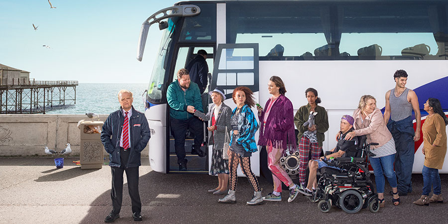 Don't Forget The Driver. Image shows from L to R: Peter Green (Toby Jones), Squeaky Dave (Danny Kirrane), Joy (Marcia Warren), Kayla (Erin Kellyman), Bradley (Jo Eaton-Kent), Rita (Luwam Teklizgi), Kieran (Wills Whittington), Fran (Claire Rushbrook), Lech (Dino Kelly), Manju (Bharti Patel).
