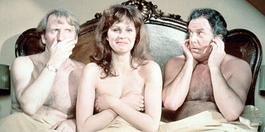 Don't Just Lie There, Say Something!. Image shows from L to R: Sir William 'Billy' Mannering-Brown MP (Leslie Phillips), Gisele Parkyn (Joanna Lumley), Barry Ovis MP (Brian Rix). Copyright: ITV Studios / Rank Organisation.