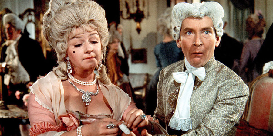 Don't Lose Your Head. Image shows from L to R: Desiree Dubarry (Joan Sims), Citizen Camembert (Kenneth Williams). Copyright: Peter Rogers Productions.