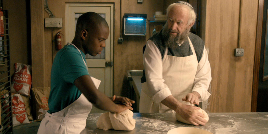 Dough. Image shows from L to R: Ayyash (Jerome Holder), Nat Dayan (Jonathan Pryce).