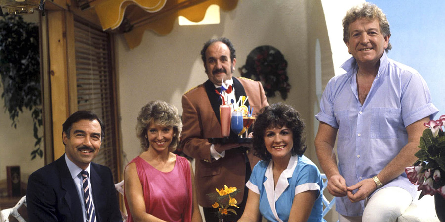 Duty Free. Image shows from L to R: Robert Cochran (Neil Stacy), Linda Cochran (Joanna Van Gyseghem), Carlos (Carlos Douglas), Amy Pearce (Gwen Taylor), David Pearce (Keith Barron). Copyright: Yorkshire Television.