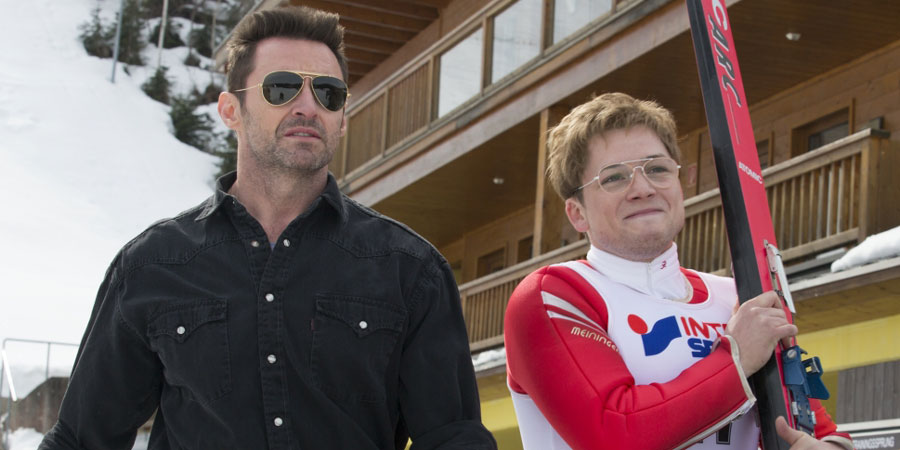 Eddie The Eagle. Image shows from L to R: Bronson Peary (Hugh Jackman), Michael 'Eddie' Edwards (Taron Egerton).