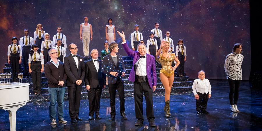 The Entire Universe. Image shows from L to R: Robin Ince, Eric Morecambe (Jonty Stephens), Ernie Wise (Ian Ashpitel), Brian Cox, Eric Idle, Hannah Waddingham, Warwick Davis, Noel Fielding. Copyright: BBC / Guy Levy.