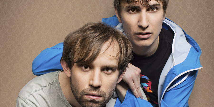 Flat TV. Image shows from L to R: Naz (Naz Osmanoglu), Tom (Tom Rosenthal). Copyright: BBC.