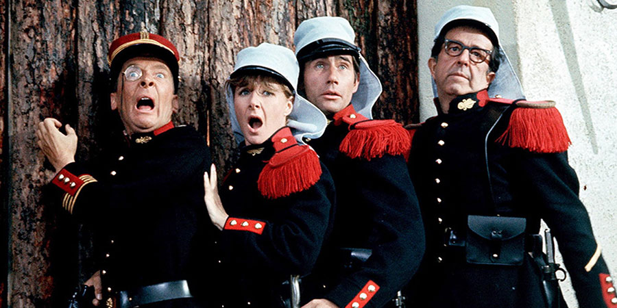 Follow That Camel. Image shows from L to R: Commandant Maximilian Burger (Kenneth Williams), Lady Jane Ponsonby (Angela Douglas), Bertram 'Bo' Oliphant West (Jim Dale), Sergeant Ernie Nocker (Phil Silvers). Copyright: Peter Rogers Productions.