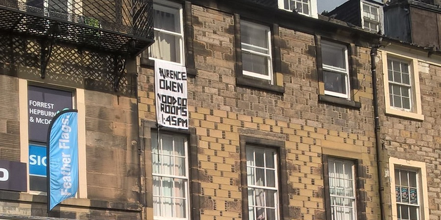 Laurence Owen has put a bedsheet out his window to promote his show. Copyright: BCG.