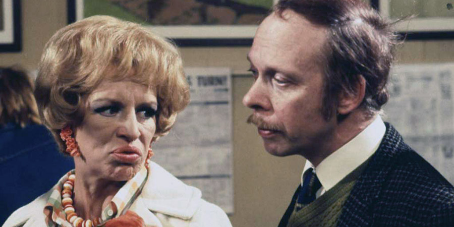 George & Mildred. Image shows from L to R: Mildred Roper (Yootha Joyce), George Roper (Brian Murphy). Copyright: Thames Television.