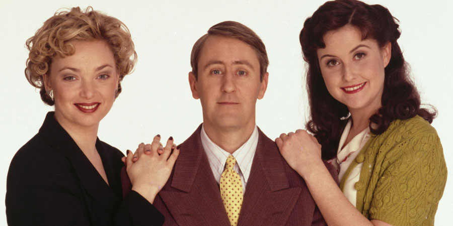 Goodnight Sweetheart. Image shows from L to R: Yvonne Sparrow (Emma Amos), Gary Sparrow (Nicholas Lyndhurst), Phoebe Sparrow (Elizabeth Carling). Copyright: Alomo Productions / BBC.