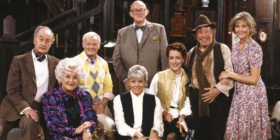 Grace & Favour. Image shows from L to R: Captain Stephen Peacock (Frank Thornton), Mrs. Betty Slocombe (Mollie Sugden), Mr. Wilberforce Clayborne Humphries (John Inman), Miss Shirley Brahms (Wendy Richard), Mr. Cuthbert Rumbold (Nicholas Smith), Jessica Lovelock (Joanne Heywood), Maurice Moulterd (Billy Burden), Mavis Moulterd (Fleur Bennett). Copyright: BBC.