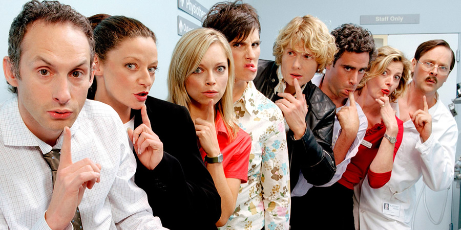 Green Wing. Image shows from L to R: Martin Dear (Karl Theobald), Sue White (Michelle Gomez), Angela Hunter (Sarah Alexander), Caroline Todd (Tamsin Greig), Mac Macartney (Julian Rhind-Tutt), Guy Secretan (Stephen Mangan), Joanna Clore (Pippa Haywood), Alan Statham (Mark Heap). Copyright: Talkback Productions.